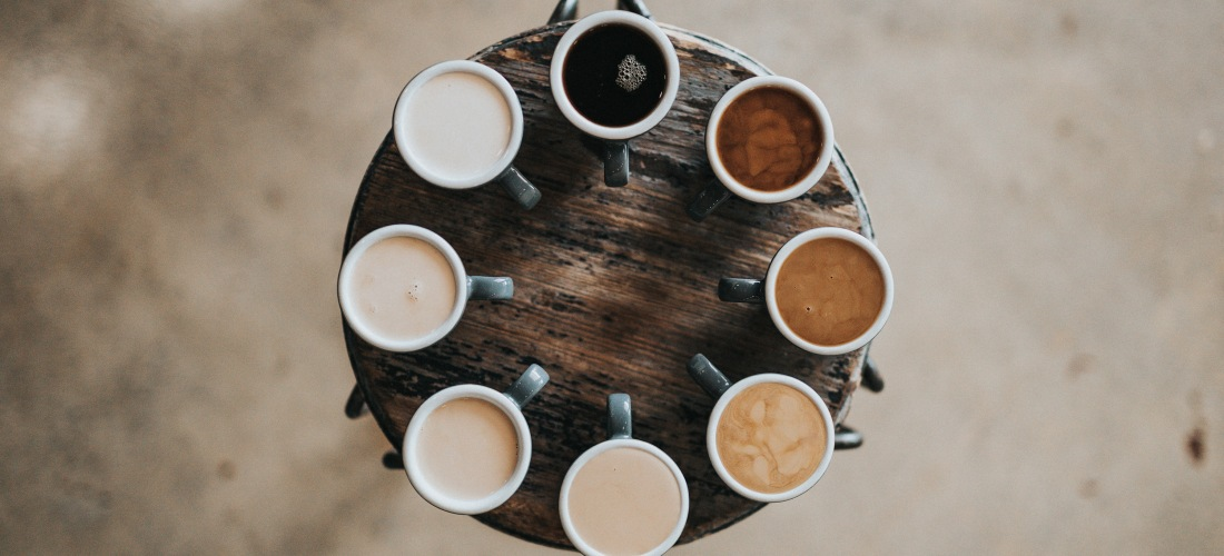 A serving tray of various coffee beverages